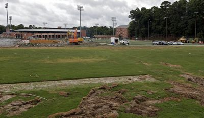 This photo taken Wednesday, June 21, 2017, shows renovation at the football practice facility and the lacrosse field at the University of North Carolina in Chapel Hill, N.C. North Carolina athletic director Bubba Cunningham has talked for years about the need to build an indoor football practice facility among a series of facility upgrades. That work _ part of a $100 million project _ is underway to close a 2016-17 sports season that saw UNC win a men's basketball national championship and continue to deal with its multi-year NCAA academic scandal. (AP Photo/Gerry Broome)