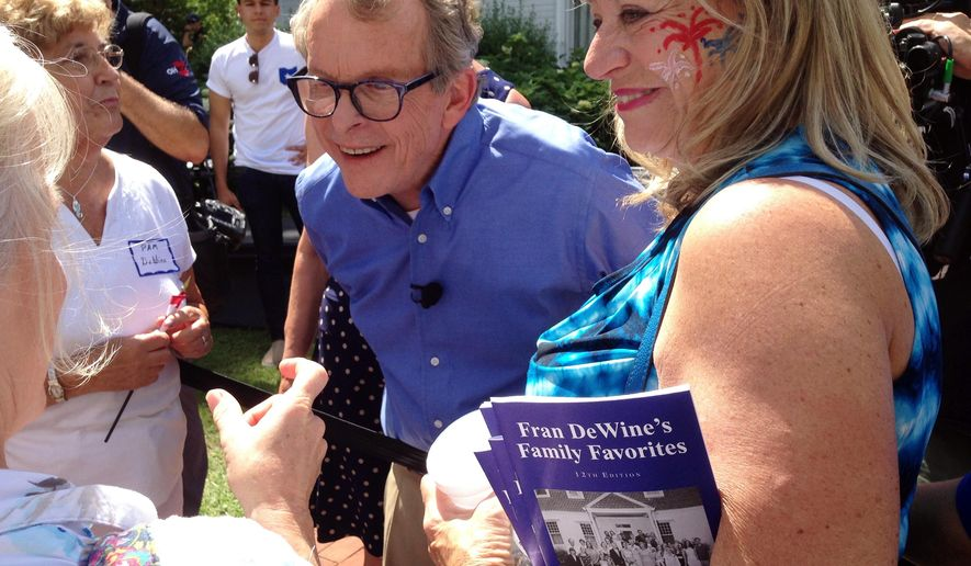 Republican Attorney General Mike DeWine greets supporters at his home in Cedarville, Ohio, on Sunday, June 25, 2017, after announcing he is running for governor. (AP Photo/Julie Carr Smyth)