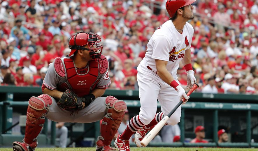 St. Louis Cardinals' Randal Grichuk, right, and Cincinnati Reds catcher Devin Mesoraco watch Grichuk's two-run home run during the fourth inning of a baseball game Monday, June 26, 2017, in St. Louis. (AP Photo/Jeff Roberson)