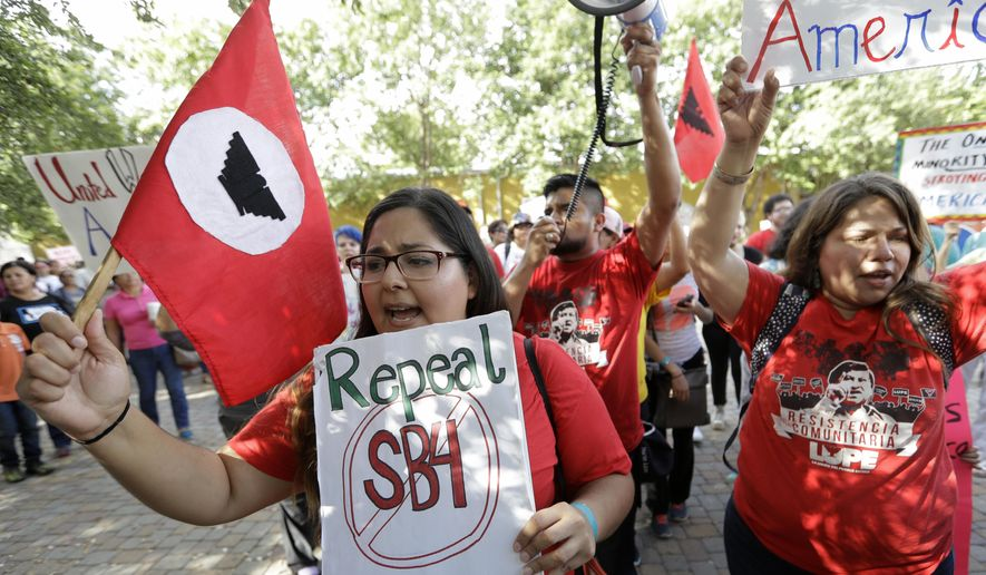 "Protesters march to oppose a new Texas ""sanctuary cities"" bill that aligns with the president's tougher stance on illegal immigration, Monday, June 26, 2017, in San Antonio. (AP Photo/Eric Gay)"