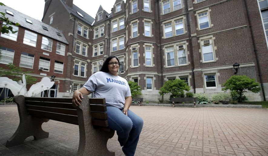 In this June 16, 2017, photo, Danielle Ramos, 30, poses at MassBay Community College in Wellesley, Mass., where she pursued her education after being defrauded by a for-profit college. Thousands of students who were defrauded by for-profit colleges were told by the Obama administration that their student loans would be forgiven, but the Trump administration has yet to keep that promise. (AP Photo/Elise Amendola)