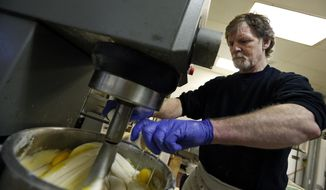 Masterpiece Cakeshop owner Jack Phillips cracks eggs into a cake batter mixer inside his store in Lakewood, Colo. The Supreme Court is taking on a new clash between gay rights and religion in a case about a wedding cake for a same-sex couple in Colorado. The justices said Monday, June 26, 2017, they will consider whether a baker who objects to same-sex marriage on religious grounds can refuse to make a wedding cake for a gay couple.  (AP Photo/Brennan Linsley, File)