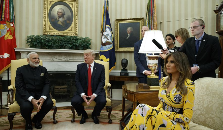 President Donald Trump, accompanied by first lady Melania Trump, meets with Indian Prime Minister Narendra Modi in the Oval Office of the White House in Washington, Monday, June 26, 2017. (AP Photo/Evan Vucci)