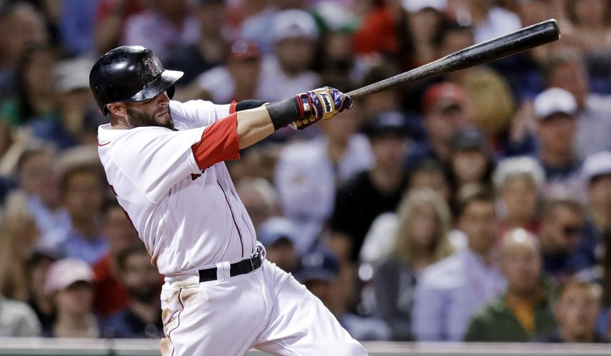 Boston Red Sox's Dustin Pedroia follows through on an RBI single during the seventh inning of a baseball game against the Minnesota Twins at Fenway Park in Boston, Monday, June 26, 2017. (AP Photo/Charles Krupa)