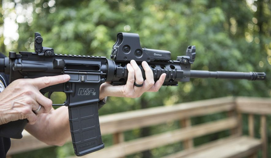 In this June 24, 2016, file photo, an AR-15 is held in Auburn, Ga. Gun rights advocates entered the Trump era with high hopes. After years of frustration, they thought a gun-friendly president and Congress would advance their agenda. (AP Photo/Lisa Marie Pane)