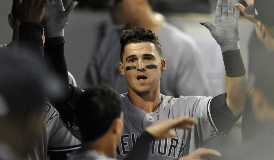 New York Yankees' Tyler Austin celebrates with teammates in the dugout after hitting a solo home run during the sixth inning of a baseball game against the Chicago White Sox, Monday, June 26, 2017, in Chicago. (AP Photo/Paul Beaty)