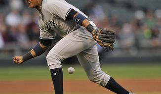 New York Yankees second baseman Starlin Castro bobbles a single hit by Chicago White Sox's Jose Abreu during the first inning of a baseball game, Monday, June 26, 2017, in Chicago. (AP Photo/Paul Beaty)