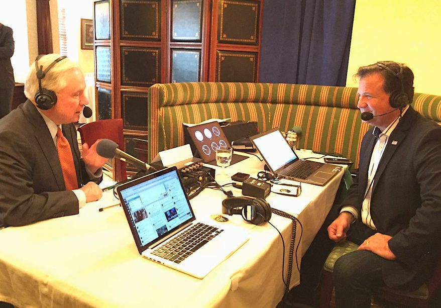 """Talk radio host Lars Larson interviews then-Sen. Jeff Sessions during the 2016 """"Hold Their Feet to the Fire"""" broadcast event organized by the Federation for Immigration Reform. (Lars Larson)"""