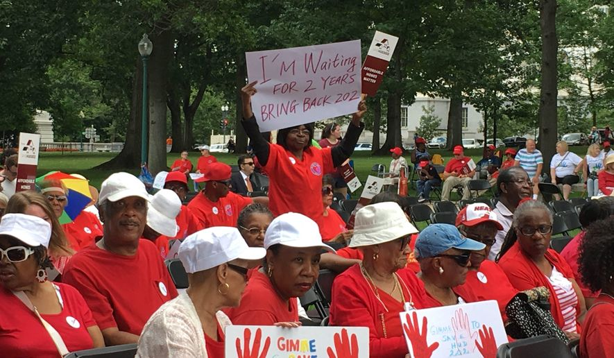 Participants of the Save HUD 202 rally voice their support for affordable housing for seniors outside the U.S. Capitol on Tuesday. (Sarah Nelson/The Washington Times)