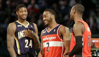 Paul George of the Indiana Pacers, John Wall of the Washington Wizards and Terrence Ross celebrate winning the freestyle round of the slam dunk contest at the NBA All-Star weekend in New Orleans on Feb. 15, 2014. (Associated Press) **FILE**