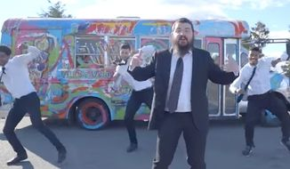 A Jewish artist's iconic minibus, featured in a music video by Jewish singer Benny Friedman (pictured here), was found torched Monday in Brooklyn. (YouTube/@Benny Friedman)
