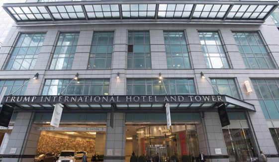 This Dec. 9, 2015, file photo, shows the entrance to the Trump International Hotel and Tower in Toronto. The high-end hotel and condominium tower in Toronto will no longer bear the Trump brand name. An investment partnership recently acquired the 65-story tower from the developer and the property will no longer be managed by the Trump Organization. (Graeme Roy/The Canadian Press via AP, File) **FILE**