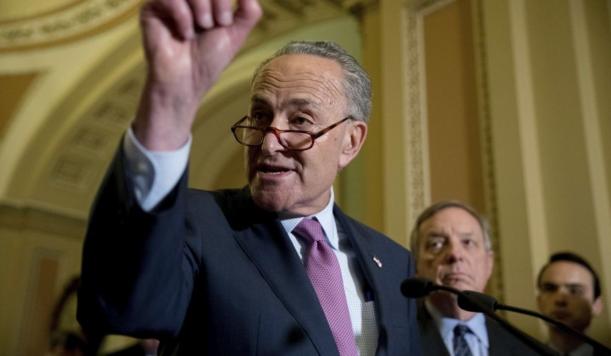 Senate Minority Leader Sen. Chuck Schumer of N.Y. accompanied by Senate Minority Whip Richard Durbin of Ill., right, speaks to reporters after GOP leadership announce they are delaying a vote on the Republican health care bill, at the Capitol in Washington, Tuesday, June 27, 2017. (AP Photo/Andrew Harnik)