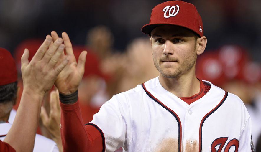 Washington Nationals Trea Turner celebrates 6-1 win over the Chicago Cubs after a baseball game, Tuesday, June 27, 2017, in Washington. (AP Photo/Nick Wass)