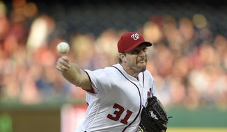 Washington Nationals starting pitcher Max Scherzer delivers a pitch during the third inning of a baseball game against the Chicago Cubs, Tuesday, June 27, 2017, in Washington. (AP Photo/Nick Wass)