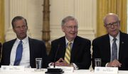 Senate Majority Leader Mitch McConnell of Ky., center, flanked by Sen. John Thune, R-S.D., left, and Sen. Pat Roberts, R-Kan., right, wait for President Donald Trump to join a meeting of Republican senators on health care in the East Room of the White House in Washington, Tuesday, June 27, 2017. (AP Photo/Susan Walsh)