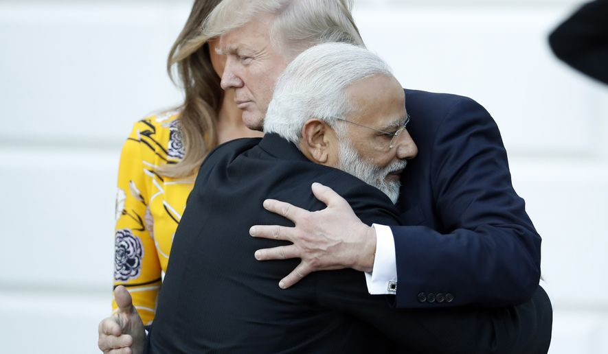 In this June 26, 2017, file photo, Indian Prime Minister Narendra Modi hugs President Donald Trump as Modi departs the White House in Washington. (AP Photo/Alex Brandon, File)
