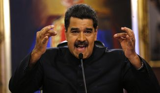 FILE - In this June 22, 2017 file photo, Venezuela's President Nicolas Maduro gives a news conference in Caracas, Venezuela.  Maduro said a helicopter fired on Venezuela's Supreme Court in a confusing incident that he claimed was part of a conspiracy to destabilize his socialist government, on Tuesday, June 27, 2017. (AP Photo/Ariana Cubillos, File)