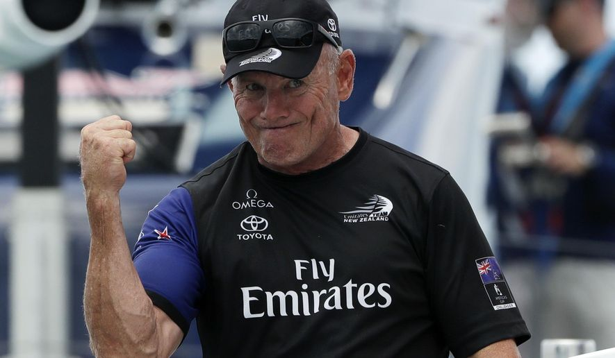 Emirates Team New Zealand CEO Grant Dalton celebrates after defeating Oracle Team USA to win the America's Cup sailing competition Monday, June 26, 2017, in Hamilton, Bermuda. (AP Photo/Gregory Bull)