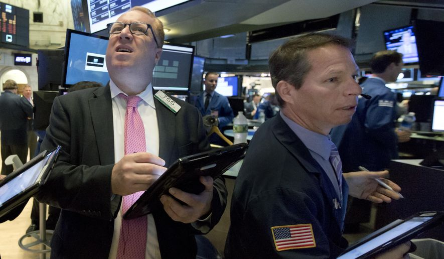Trader Daniel Ryan, left, and Robert Charmak work at the post that handles Pandora on the floor of the New York Stock Exchange, Tuesday, June 27, 2017. Pandora, under intensifying pressure from Spotify and Apple Music, said Tuesday that CEO Tim Westergren has stepped down from that role. (AP Photo/Richard Drew)