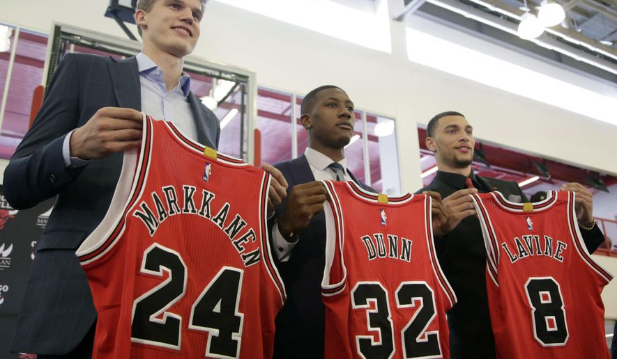Chicago Bulls seventh overall draft pick Lauri Markkanen, left, Kris Dunn, center, and Zach Levine, pose for a photo at the NBA basketball team's training facility, Tuesday, June 27, 2017, in Chicago. Dunn and Levine was acquired by the Bulls from the Minnesota Timberwolves in exchange for Jimmy Butler and this year's No. 16th overall pick, Justin Patton. (AP Photo/G-Jun Yam)