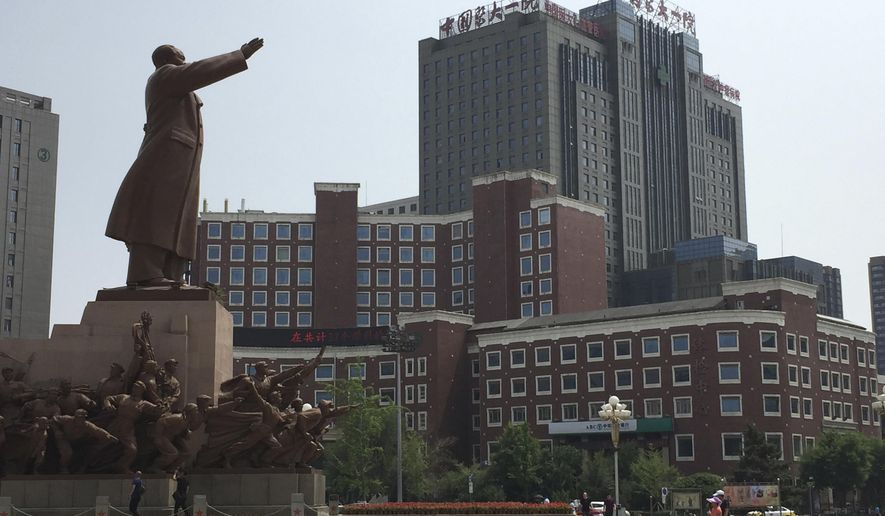 "A statue of late paramount leader Mao Zedong looks over the complex of the China Medical University No. 1 Affiliated Hospital where imprisoned Chinese Nobel Peace Prize laureate and dissident Liu Xiaobo is believed to have been transferred to after being diagnosed with late-stage liver cancer in Shenyang in northeastern China's Liaoning province, Tuesday, June 27, 2017. The deteriorating health of China's best-known political prisoner was immediately met with dismay and anger by the country's beleaguered community of rights activists and lawyers, who called it a blow to the democracy movement. Chinese character at top right of building reads ""Oncology Hospital."" (AP Photo/Mark Schiefelbein)"