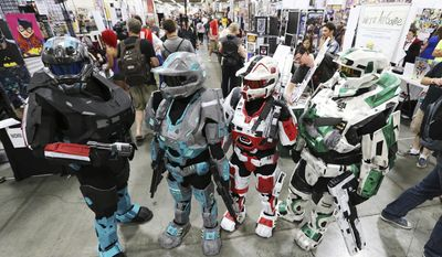 FILE - This Sept. 24, 2015, file photo, shows attendees walking through Salt Lake Comic Con 2015 in Salt Lake City. Settlement talks have broken down between the organizers of two pop-culture conventions in California and Utah known for guests' elaborate costumes, Salt Lake Comic Con officials said Tuesday, June 27, 2017. Both sides are asking a judge to decide the contest over naming rights, said Bryan Brandenburg, co-founder of Salt Lake Comic Con. (Jeffrey D. Allred/The Deseret News via AP, File)