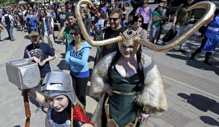 FILE- In this Sept. 4, 2017, file photo, Jessica Nowan, left and Caitlin Grandstaff, right, stand in line for the Salt Lake Comic Con at the Salt Palace Convention Center, in Salt Lake City. Settlement talks have broken down between the organizers of two pop-culture conventions in California and Utah known for guests' elaborate costumes, Salt Lake Comic Con officials said Tuesday, June 27, 2017. Both sides are asking a judge to decide the contest over naming rights, said Bryan Brandenburg, co-founder of Salt Lake Comic Con. (AP Photo/Rick Bowmer, File)