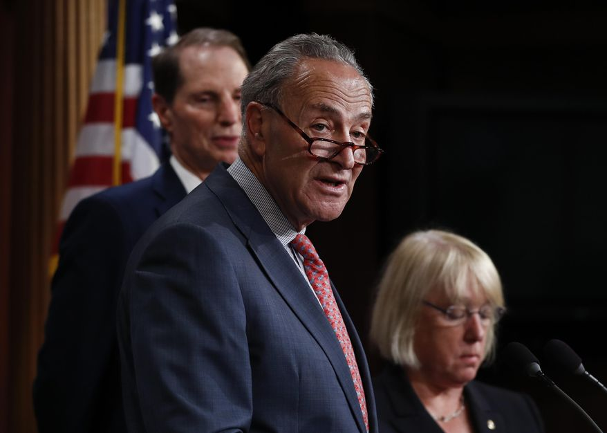 "Senate Minority Leader Chuck Schumer, D-N.Y., center, joined by Sen. Patty Murray, D-Wash., right, and Sen. Ron Wyden, D-Ore., left, speaks during a new conference on Capitol Hill in Washington, Monday, June 26, 2017, about the Senate Republicans health care bill. Senate Republicans unveil a revised health care bill in hopes of securing support from wavering GOP lawmakers, including one who calls the drive to whip his party's bill through the Senate this week ""a little offensive."" (AP Photo/Carolyn Kaster)"
