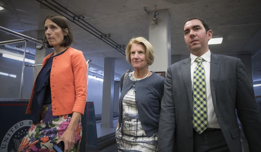 Sen. Shelley Moore Capito, R-W.V., heads to a caucus meeting with Senate Majority Leader Mitch McConnell, R-Ky., who is struggling with senators like Capito who are opposed or wavering on the Republican health care bill, at the Capitol in Washington, Tuesday, June 27, 2017. (AP Photo/J. Scott Applewhite)