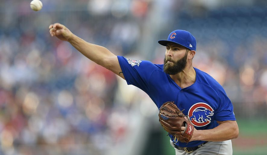 Chicago Cubs starting pitcher Jake Arrieta delivers a pitch during the first inning of a baseball game against the Washington Nationals, Tuesday, June 27, 2017, in Washington. (AP Photo/Nick Wass)
