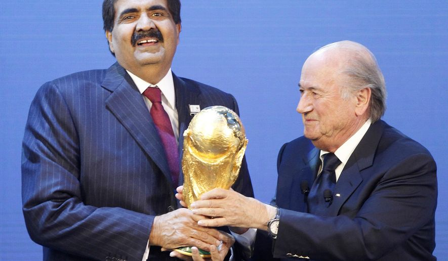 FILE- In this  Thursday, Dec. 2, 2010 file photo, Sheikh Hamad bin Khalifa Al-Thani, Emir of Qatar, left, gets the World Cup trophy by FIFA President Joseph Blatter, right, after the announcement of Qatar hosting the 2022 soccer World Cup in Zurich, Switzerland. The report into suspected corruption in the 2018-2022 World Cup bidding contests, involving 11 nations and won by Russia and Qatar, has been the mystery ever since American investigator Michael Garcia delivered it more than 2-1/2 years ago.  (AP Photo/Michael Probst, File)
