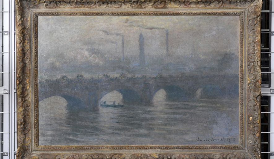 The painting 'Waterloo Bridge (1903)  by Claude Monet (1840-1926) is on display  during a press talk on the preparations of an exhibition of exemplary works from the Gurlitt found, an art collection of Cornelius Gurlitt discovered in 2012, in November in Bonn, Germany,  Tuesday June, 27, 2017. (Henning Kaiser/dpa via AP)