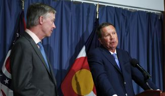 Ohio Gov. John Kasich, right, joined by Colorado Gov. John Hickenlooper, speaks during a news conference at the National Press Club in Washington, Tuesday, June 27, 2017, about Republican legislation overhauling the Obama health care law. (AP Photo/Carolyn Kaster) ** FILE **