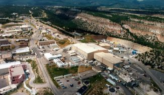 FILE - This undated aerial view shows the Los Alamos National laboratory in Los Alamos, N.M. The competition for a multibillion-dollar contract to manage the troubled Los Alamos National Laboratory is beginning after a week in which the northern New Mexico facility was hit with criticism for its record of safety lapses.   (The Albuquerque Journal via AP, File)