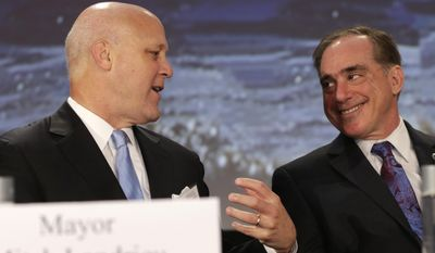 New Orleans Mayor Mitch Landrieu, left, talks with Veterans Affairs Secretary David Shulkin, right, during the annual U.S. Conference of Mayors meeting, Monday, June 26, 2017, in Miami Beach, Fla. (AP Photo/Lynne Sladky)