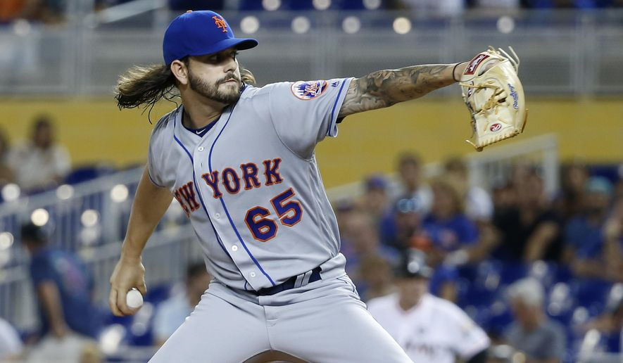 New York Mets' Robert Gsellman delivers a pitch during the first inning of a baseball game against the Miami Marlins, Tuesday, June 27, 2017, in Miami. (AP Photo/Wilfredo Lee)