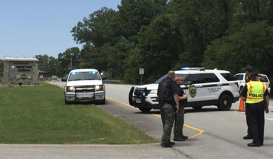"Authorities block an entrance to Redstone Arsenal, Tuesday, June 27, 2017, in Huntsville, Ala. The military post said in a tweet it was on lockdown Tuesday amid reports of possible active shooter, telling workers to ""run hide fight."" More than 30,000 government employees, civilians and contractors work daily at Redstone. It is home to Army missile defense programs and other military offices. (AP Photo/Eric Schultz)"