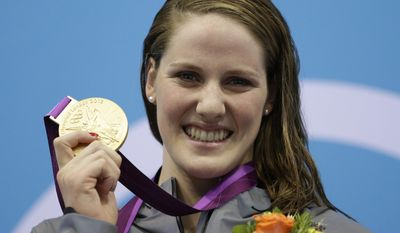 FILE - In this July 30, 2012, file photo, United States' Missy Franklin poses with her gold medal for the women's 100-meter backstroke swimming final at the Aquatics Centre in the Olympic Park during the 2012 Summer Olympics in London. Missy Franklin is so upbeat, so full of energy, so dang positive all the time, it's hard to imagine her ever going to a dark place. (AP Photo/Michael Sohn, File)