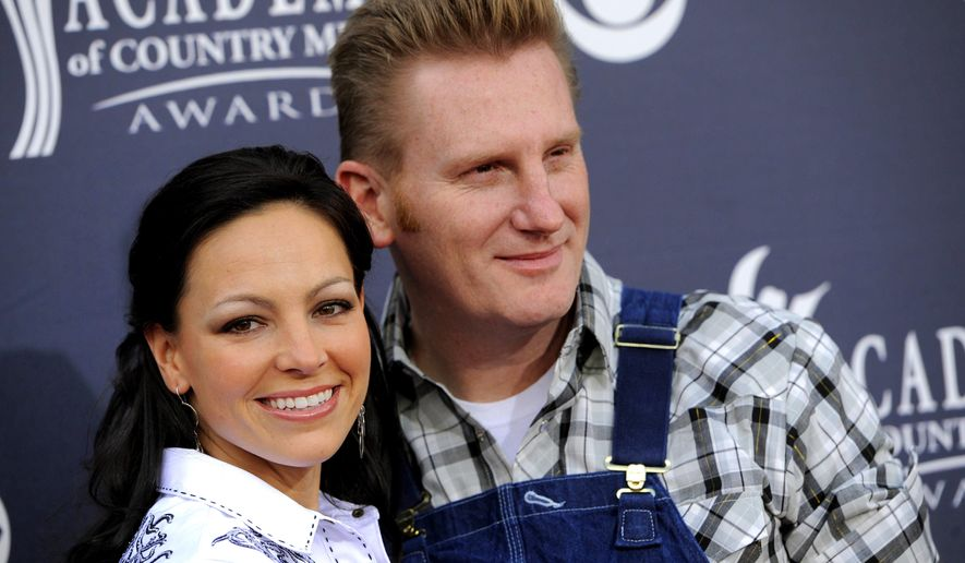 "FILE - In this April 3, 2011, file photo, Joey Feek, left, and her husband Rory Feek, of ""Joey + Rory,"" arrive at the Annual Academy of Country Music Awards in Las Vegas. Rory Feek  announced he will perform publicly for the first time since his wife Joey died last year to raise funds for the Music Health Alliance, a nonprofit that helped his family with insurance and medical bills. (AP Photo/Chris Pizzello, File)"