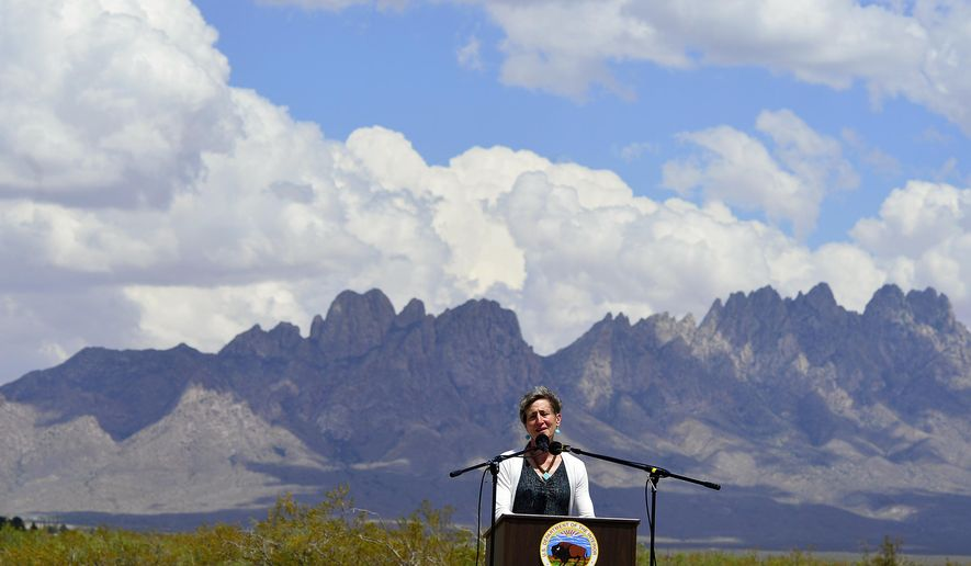 FILE - In this May 23, 2014 file photo, Secretary of the Interior Sally Jewell speaks with the local community and other federal, state, tribal and local leaders celebrating President Obama's designation of the Organ Mountains-Desert Peaks National Monument at Onate High School in Las Cruces, N.M. The Organ Mountains-Desert Peaks National Monument is among 27 monuments where a review has been ordered by President Donald Trump that might remove protections previously considered irreversible.  (Carlos Javier Sanchez/The Las Cruces Sun-News via AP, file)