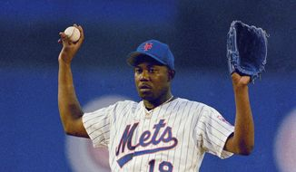 FILE - In this June 22, 1993, file photo, New York Mets pitcher Anthony Young calls for a a new ball during the team's baseball game against the Montreal Expos in New York. Young, who set a major league record with 27 straight losses, has died. He was 51.The Mets said Young died Tuesday, June 27, 2017, in Houston after a long illness. He had told former teammates this spring that he had a brain tumor. (AP Photo/Ron Frehm, File)
