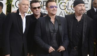 FILE - This Jan. 12, 2014 file photo shows members of the Irish rock band U2, from left, Adam Clayton, Larry Mullen, Jr., Bono, and The Edge at the 71st annual Golden Globe Awards at the Beverly Hilton Hotel in Beverly Hills, Calif. Clayton thanked his bandmates on Monday, June 26, 2017, for their support during his treatment and recovery from alcohol abuse years ago, before joining them for a rollicking rendition of a few hits. Clayton received an award Monday at a Manhattan theater from MusiCares, a foundation that helps musicians get treatment for addiction. (Photo by Jordan Strauss/Invision/AP, File)