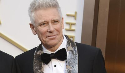 FILE- In this March 2, 2014, file photo, Adam Clayton of U2 arrives at the Oscars at the Dolby Theatre in Los Angeles. Clayton thanked his bandmates for their support during his treatment and recovery from alcohol abuse years ago, before joining them for a rollicking rendition of a few hits. Clayton received an award Monday, June 26, 2017, at a Manhattan theater from MusiCares, a foundation that helps musicians get treatment for addiction. (Photo by Jordan Strauss/Invision/AP, File)