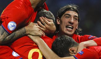 Spain's Saul Niguez celebrates with teammates after scoring during the Euro Under 21 semifinal soccer match between Italy and Spain, at the Krakow Stadium, Poland, Tuesday, June 27, 2017. (AP Photo/Czarek Sokolowski)