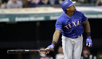 Texas Rangers' Adrian Beltre watches the ball after hitting a solo home run off Cleveland Indians relief pitcher Cody Allen in the ninth inning of a baseball game, Tuesday, June 27, 2017, in Cleveland. (AP Photo/Tony Dejak)