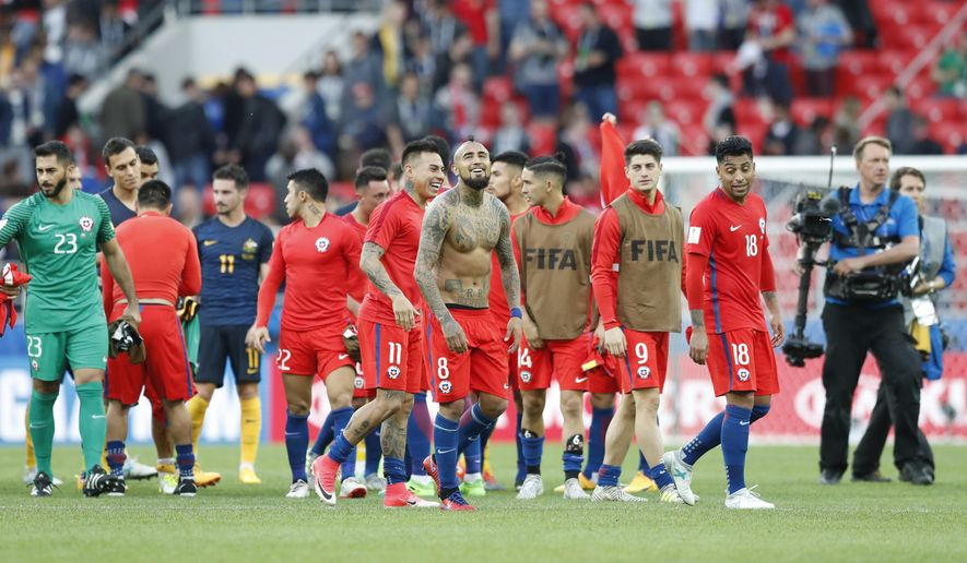 Chile players applaud fans at the end of the Confederations Cup, Group B soccer match between Chile and Australia, at the Spartak Stadium in Moscow, Sunday, June 25, 2017. (AP Photo/Pavel Golovkin)