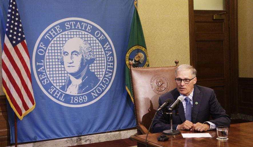Gov. Jay Inslee talks to reporters about ongoing budget negotiations, on Tuesday, June 27, 2017, in Olympia, Wash. If a budget isn't in place by midnight Friday, the state faces a partial government shutdown. (AP Photo/Rachel La Corte)