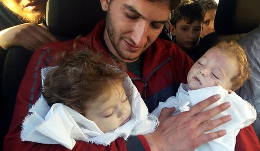 FILE -In this fie picture taken on Tuesday April 4, 2017, Abdul-Hamid Alyousef, 29, holds his twin babies who were killed during a suspected chemical weapons attack, in Khan Sheikhoun in the northern province of Idlib, Syria. The Syrian government on Tuesday, June 27, 2017 dismissed White House allegations that it was preparing a new chemical weapons attack, as activists reported an airstrike on an Islamic State-run jail in eastern Syria that they said killed more than 40 prisoners. (Alaa Alyousef via AP, File)