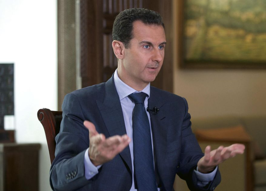 In this Wednesday, Sept. 21, 2016 photo released by the Syrian Presidency, Syrian President Bashar Assad speaks to The Associated Press at the presidential palace in Damascus, Syria. The Syrian government on Tuesday, June 27, 2017 dismissed White House allegations that it was preparing a new chemical weapons attack, as activists reported an airstrike on an Islamic State-run jail in eastern Syria that they said killed more than 40 prisoners. (Syrian Presidency via AP, File)